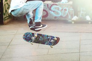 A teenager is doing a trick on a skateboard. They are feeling like themselves again after starting teen counseling with Barton Counseling Services in Katy, Texas.